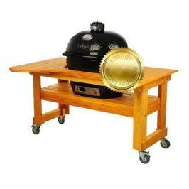 Гриль угольный Oval XL Luxury, на столе из лиственницы 778PL Primo
